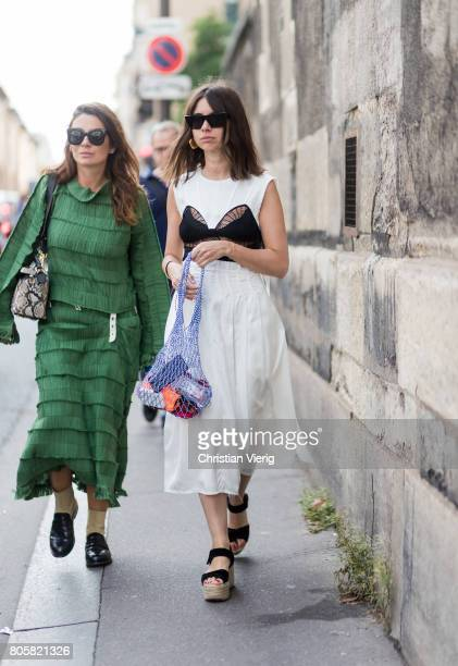 Natasha Goldenberg wearing a white dress platform sandals outside Rodarte during Paris Fashion Week Haute Couture Fall/Winter 20172018 Day One on...