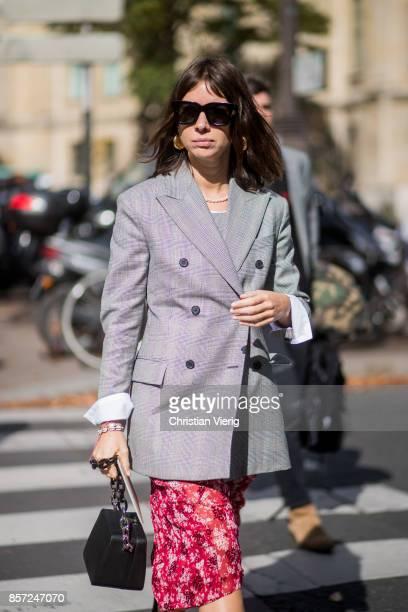 Natasha Goldenberg wearing grey checked blauer red skirt seen outside Miu Miu during Paris Fashion Week Spring/Summer 2018 on October 3 2017 in Paris...