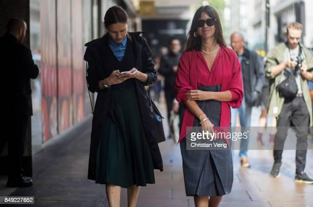 Natasha Goldenberg wearing red blouse grey checked skirt outside Erdem during London Fashion Week September 2017 on September 18 2017 in London...