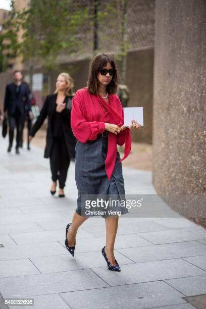 Natasha Goldenberg wearing red blouse grey skirt outside Christopher Kane during London Fashion Week September 2017 on September 18 2017 in London...