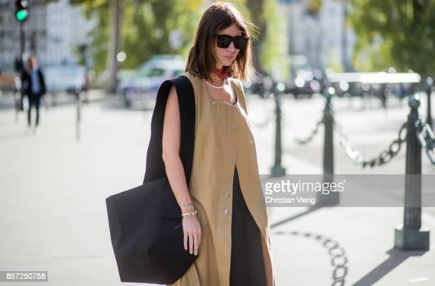 Natasha Goldenberg wearing sleeveless coat seen outside Thom Browne during Paris Fashion Week Spring/Summer 2018 on October 3 2017 in Paris France