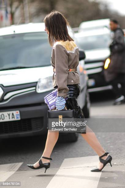 Natasha Goldenberg wears a Miu Miu jacket outside the Miu Miu show during Paris Fashion Week Womenswear Fall/Winter 2017/2018 on March 7 2017 in...