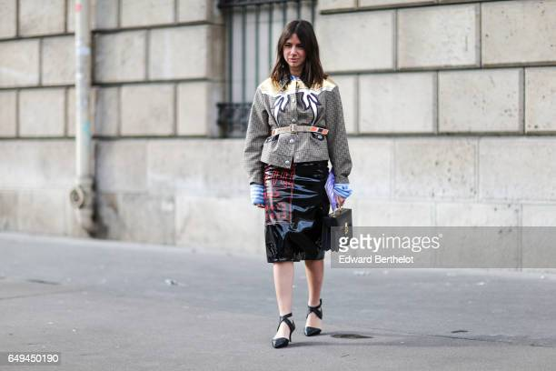 Natasha Goldenberg wears a Miu Miu skirt outside the Miu Miu show during Paris Fashion Week Womenswear Fall/Winter 2017/2018 on March 7 2017 in Paris...