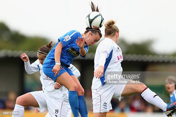 Natasha Harding of Bristol Academy Women's FC wins a header in front of Laura Bassett and Emily Westwood of Birmingham City Ladies FC during the FA...