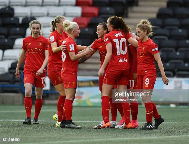 Natasha Harding of Liverpool Ladies celebrates with her team mates after scoring the second goal making it 22 during a Women's Super League match...