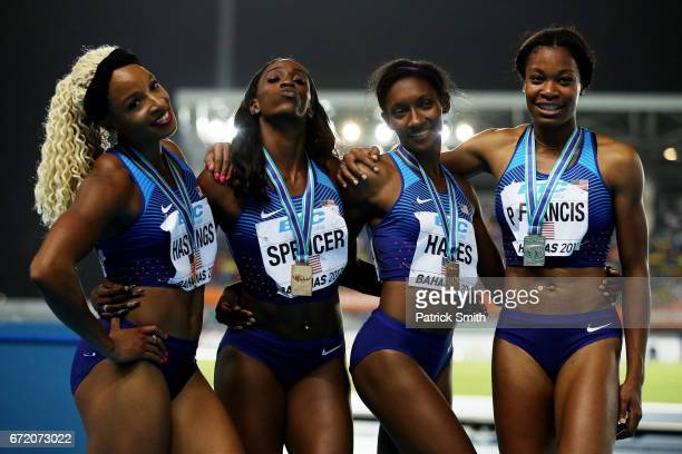 Natasha Hastings Ashley Spencer Quanera Hayes and Phyllis Francis of the USA pose on the podium after finishing first in the Women's 4x400 Metres...