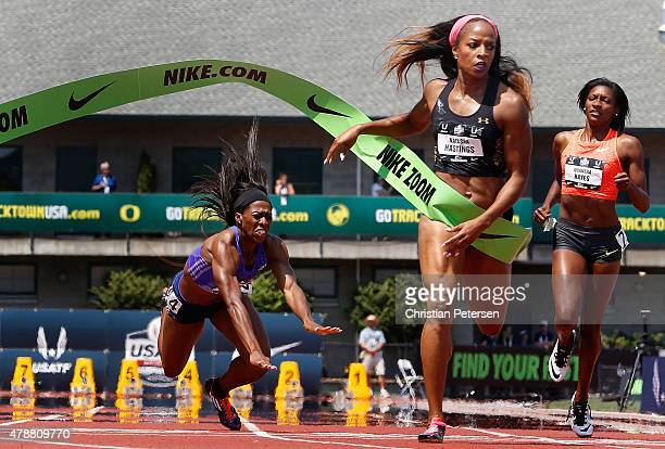 Natasha Hastings crosses the finish line to take second place ahead of Francena McCorory and Quanera Hayes in the Women's 400 Meter Dash final during...
