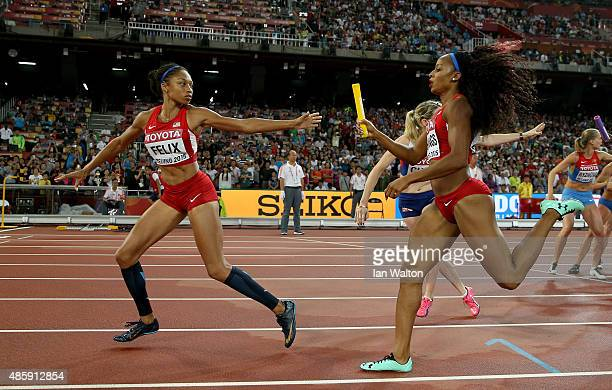 Natasha Hastings of the United States hands over to Allyson Felix of the United States in the Women's 4x400 Relay Final during day nine of the 15th...