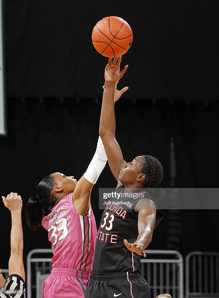 Natasha Howard #33 of the Florida State Seminoles and Suriya McGuire #33 of the Miami Hurricanes battle for the opening tip-off on February 10, 2013 at the BankUnited Center in Coral Gables, Florida. The Seminoles defeated the Hurricanes 93-78.