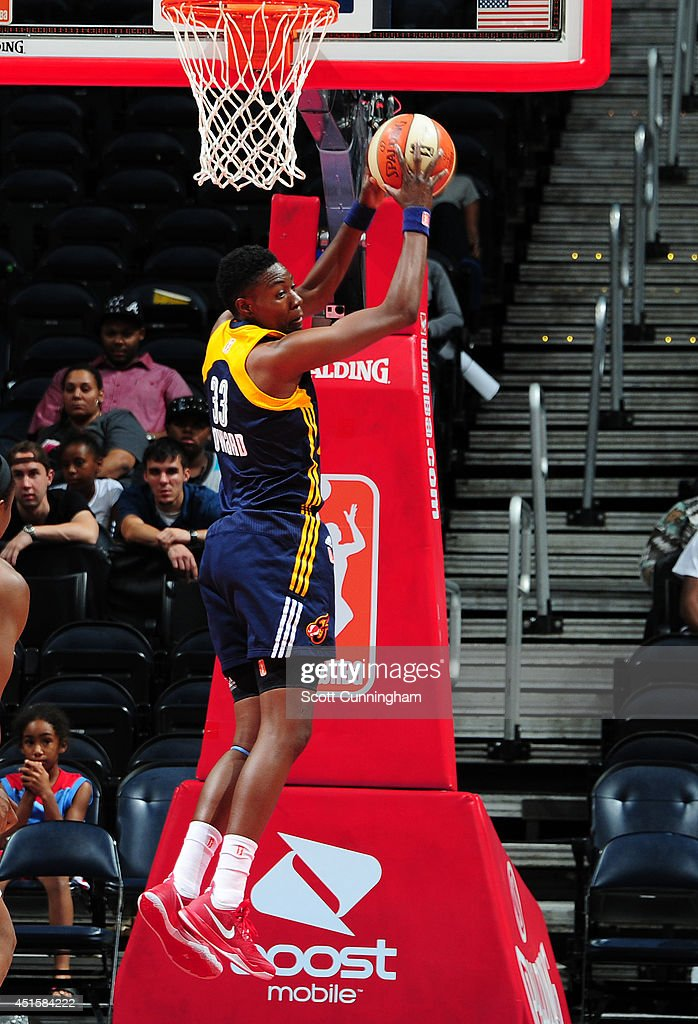 Natasha Howard #33 of the Indiana Fever grabs a rebound against the Atlanta Dream on July 1, 2014 at Philips Arena in Atlanta, Georgia.