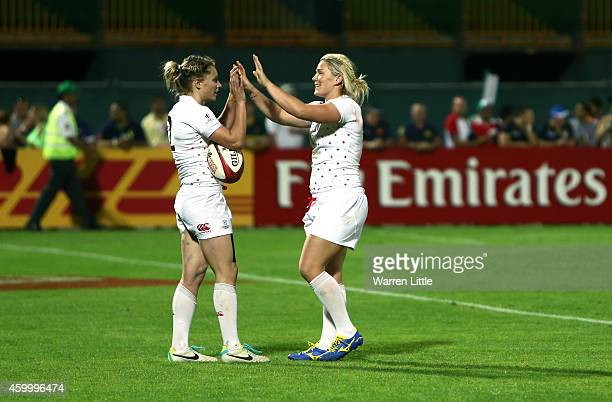 Natasha Hunt of England is congratulated after scoring the winning try against Fiji during the IRB Women's Sevens World Series Plate Final on...