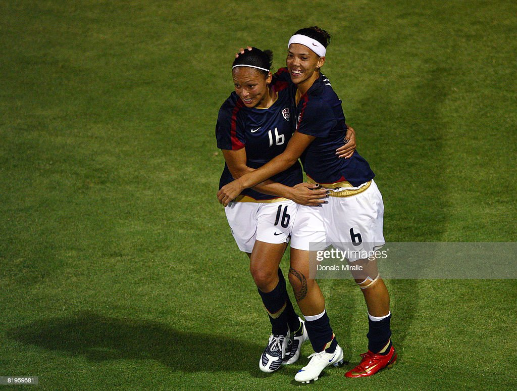 Natasha Kai of the United States is congratulated by teammate Angela Hucles after Kai's goal in the final minutes against Brazil during the...