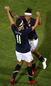 Natasha Kai of the United States is congratulated by teammate Carli Lloyd after Kai's goal in the final minutes against Brazil during the...