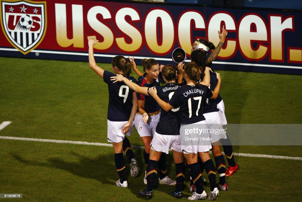 Natasha Kai of the United States is mobbed by her teammates after her goal in the final minutes against Brazil during the International Friendly...