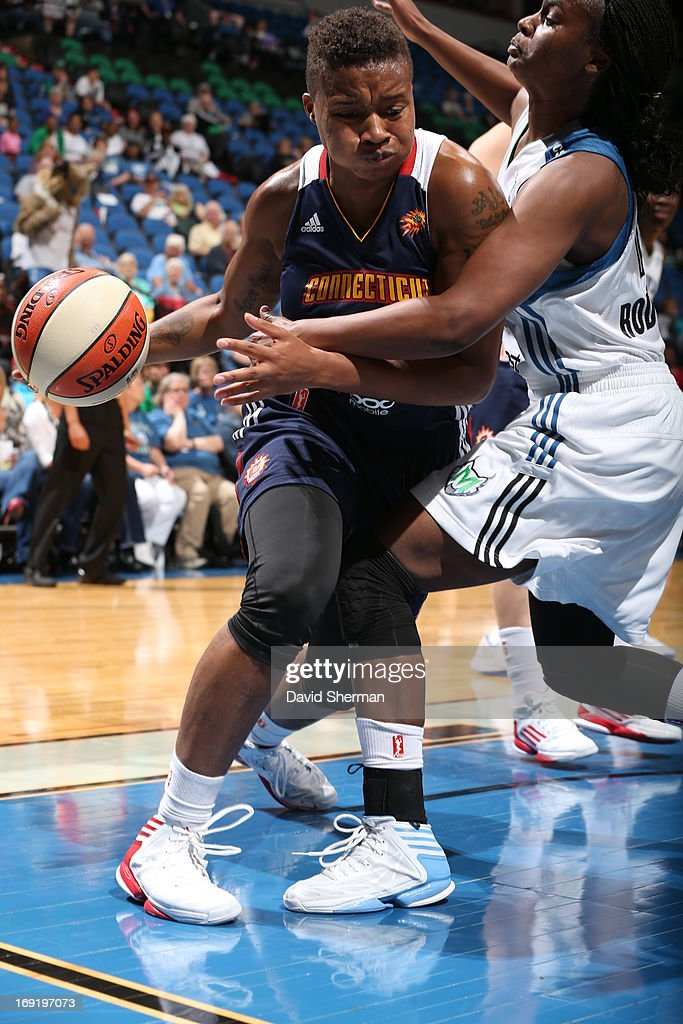 Natasha Lacy #11 of the Connecticut Sun drives in during the WNBA pre-season game against the Minnesota Lynx on May 21, 2013 at Target Center in Minneapolis, Minnesota.