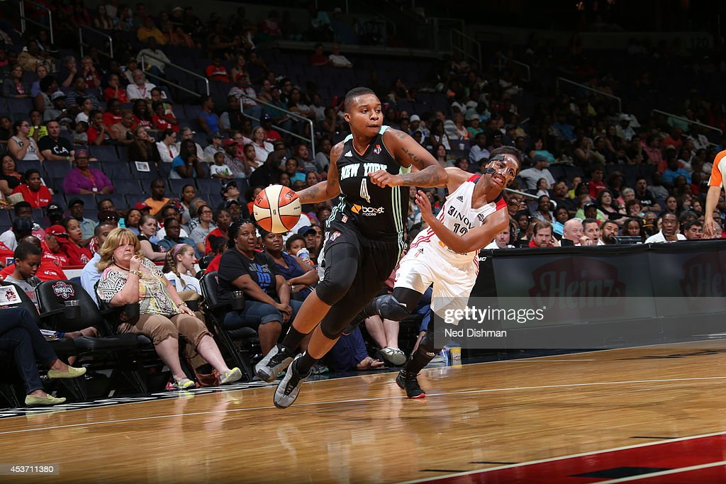 Natasha Lacy #4 of the New York Liberty drives to the basket against Ivory Latta #12 of the Washington Mystics at the Verizon Center on August 16, 2014 in Washington, DC.