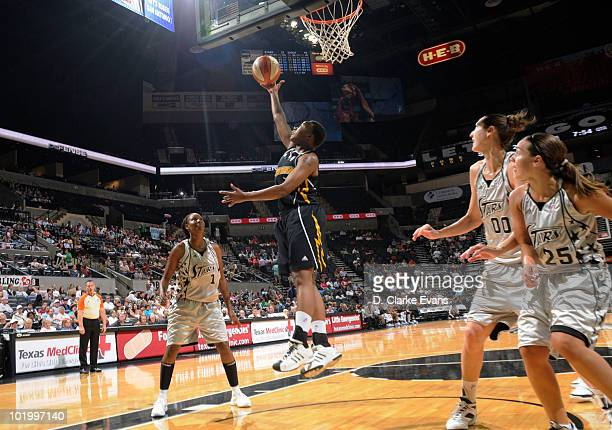 Natasha Lacy of the Tulsa Shock shoots a reverse layup against Chamique Holdsclaw of the San Antonio Silver Stars on June 11 2010 at the ATT Center...