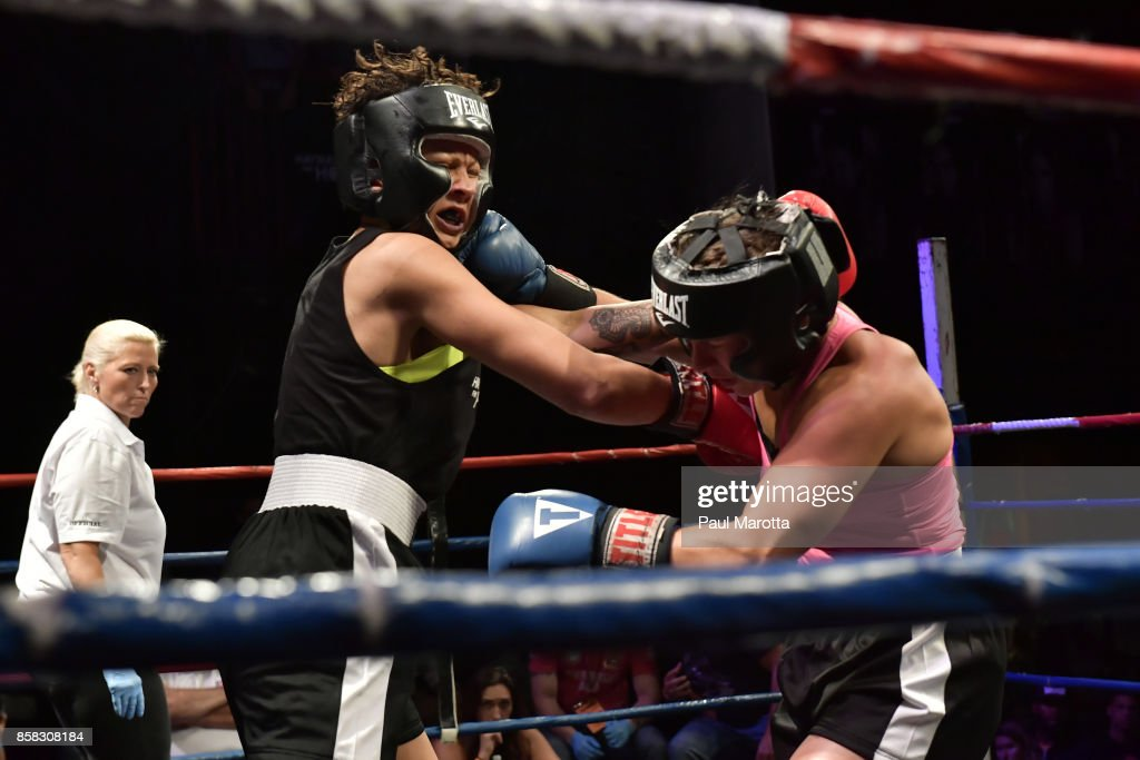 Natasha Moustache and Emily Jones in the ring at the Haymakers for Hope Fundraiser - 2017 Belles of the Brawl at House of Blues Boston on October 5, 2017 in Boston, Massachusetts. Organizers estimate app. $450,000 was raised with this single event in Boston nd more than $7.5m since its inception. Amature boxers train for four months with professional trainers and step into the ring to fight a professionally organized boxing match to raise money and awareness for cancer research.