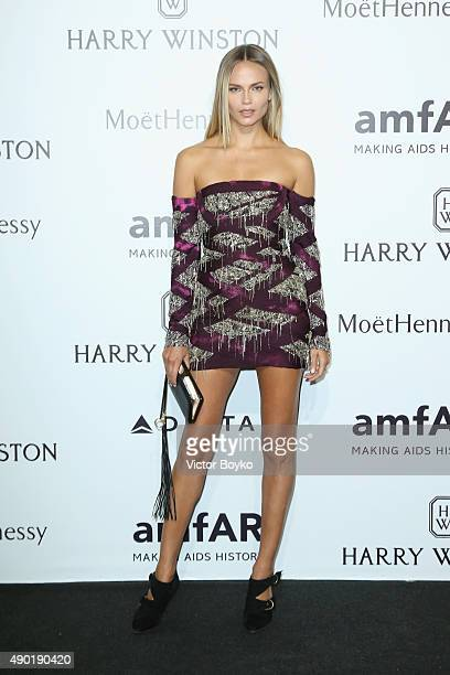 Natasha Poly attends amfAR Milano 2015 at La Permanente on September 26 2015 in Milan Italy