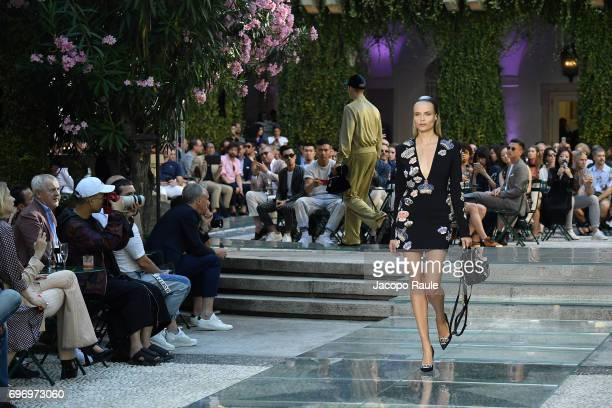 Natasha Poly walks the runway at the Versace show during Milan Men's Fashion Week Spring/Summer 2018 on June 17 2017 in Milan Italy