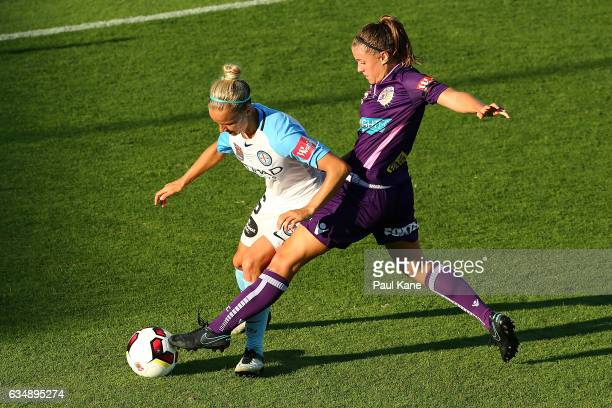 Natasha Rigby of the Perth Glory challenges Aivi Luik of Melbourne City during the 2017 WLeague Grand Final match between the Perth Glory and...