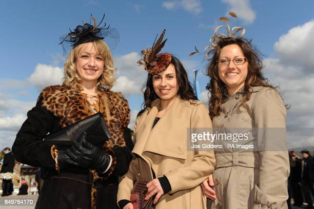 Natasha Smith and Alexandra Martll from Ross on Wye attend Ladies Day at Cheltenham Racecourse Gloucestershire with Svitlana Musial from Ledbury