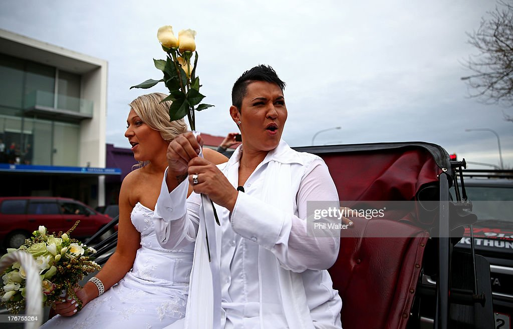 Natasha Vitali (L) and Melissa Ray (R) celebrate as they leave the Auckland Unitary Church on a horse drawn cart following their wedding on August 19, 2013 in Auckland, New Zealand. New Zealand passed a bill to legalize same-sex marriage as of August 19, 2013. New Zealand is the first coutry in Oceania to leaglize same-sex marriage.
