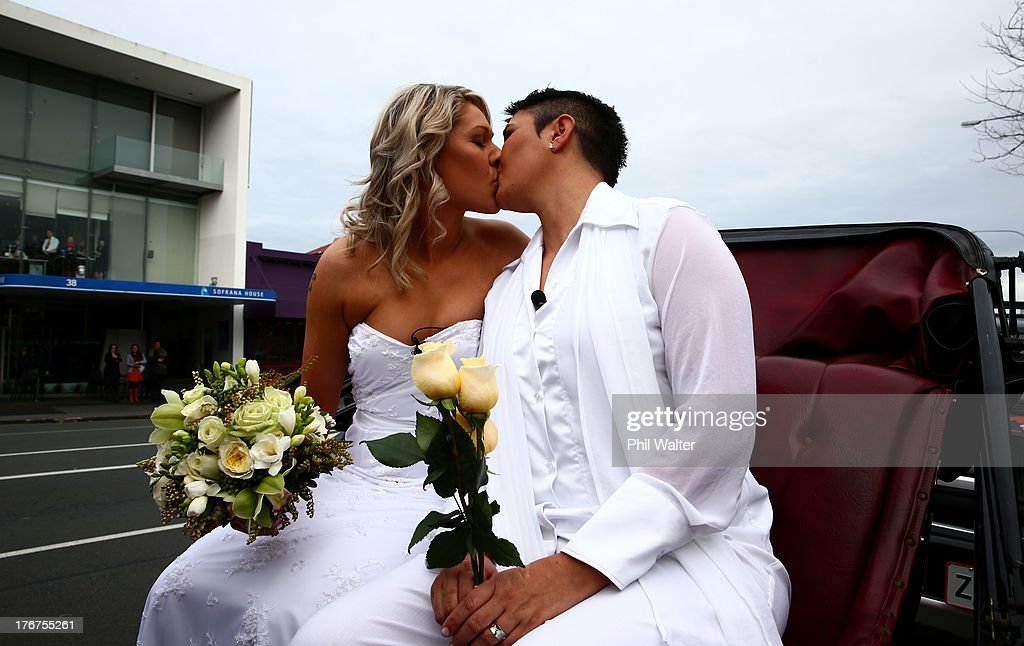 Natasha Vitali (L) and Melissa Ray (R) kiss as they leave the Auckland Unitary Church on a horse drawn cart following their wedding on August 19, 2013 in Auckland, New Zealand. New Zealand passed a bill to legalize same-sex marriage as of August 19, 2013. New Zealand is the first coutry in Oceania to leaglize same-sex marriage.