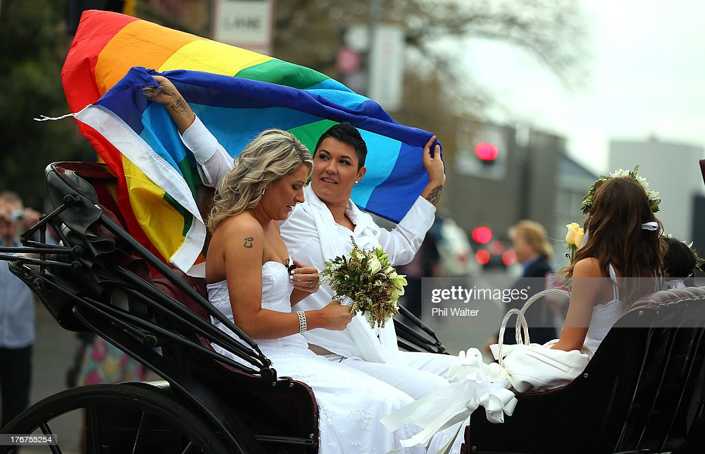 Natasha Vitali and Melissa Ray leave the Auckland Unitary Church on a horse drawn cart following their wedding on August 19, 2013 in Auckland, New Zealand. New Zealand passed a bill to legalize same-sex marriage as of August 19, 2013. New Zealand is the first coutry in Oceania to leaglize same-sex marriage.