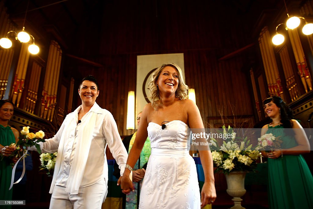 Natasha Vitali (L) and Melissa Ray (R) leave the Auckland Unitary Church following their wedding on August 19, 2013 in Auckland, New Zealand. New Zealand passed a bill to legalizen same-sex marriage as of August 19, 2013. New Zealand is the first coutry in Oceania to leaglize same-sex marriage.