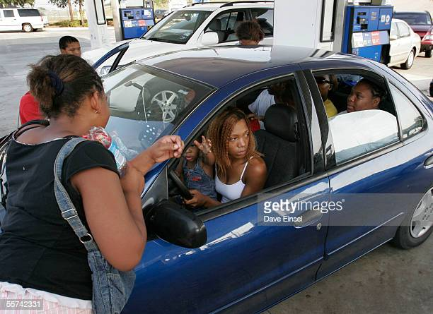 Natasha Williams sits with her daughter Destiny Stovall as she and her family wait for gas at a station on Beltway 8 September 22 2005 west of...