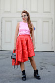Natasha Zinko poses wearing Dior top and skirt Hermes bag and Alexander McQueen shoes on the streets of Paris on October 1 2014 in Paris France