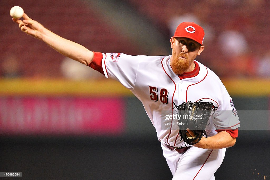 Nate Adcock #58 of the Cincinnati Reds pitches in the ninth inning against the Philadelphia Phillies at Great American Ball Park on June 9, 2015 in Cincinnati, Ohio. Cincinnati defeated Philadelphia 11-2.