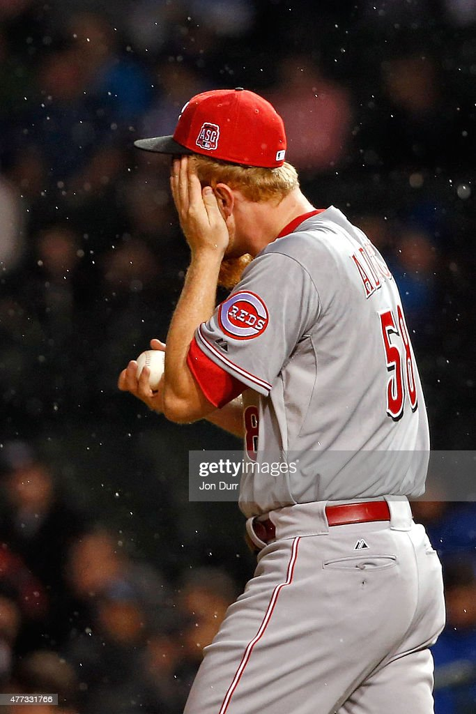 Nate Adcock #58 of the Cincinnati Reds reacts after a play against the Chicago Cubs during the seventh inning at Wrigley Field on June 11, 2015 in Chicago, Illinois.