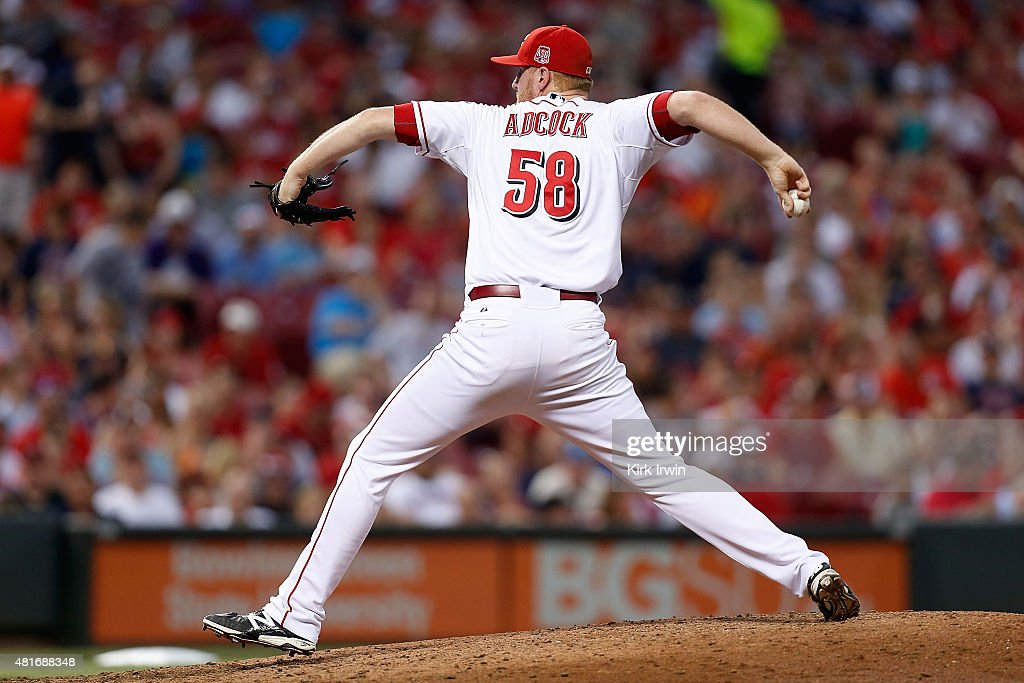Nate Adcock #58 of the Cincinnati Reds throws a pitch during the game against the Cleveland Indians at Great American Ball Park on July 18, 2015 in Cincinnati, Ohio. Cleveland defeated Cincinnati 9-4.