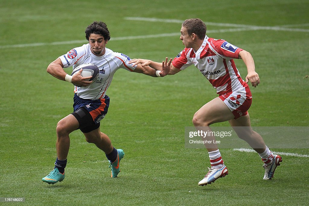 Nate Augspurger of New York holds off Steph Reynolds of Gloucester during the Plate Final match between Gloucester and New York in the World Club 7's 2013 at Twickenham Stadium on August 18, 2013 in London, England.