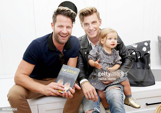 Nate Berkus and Jeremiah Brent pose with daughter Poppy BrentBerkus as they host the celebration for Tracey Hecht's new book series 'The Nocturnals'...