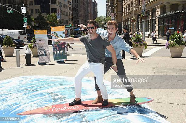 Nate Berkus and Jeremiah Brent ride a 3D wave to celebrate the Anaheim/Orange County Visitor Conventions Bureau New Brand Debut at Flatiron...