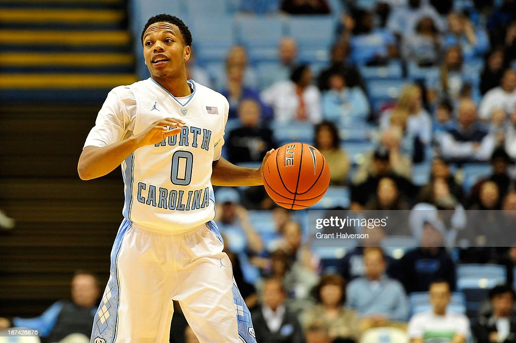 Nate Britt #0 of the North Carolina Tar Heels brings the ball up the court against the Oakland Golden Grizzlies during play at the Dean Smith Center on November 8, 2013 in Chapel Hill, North Carolina. North Carolina won 84-61.