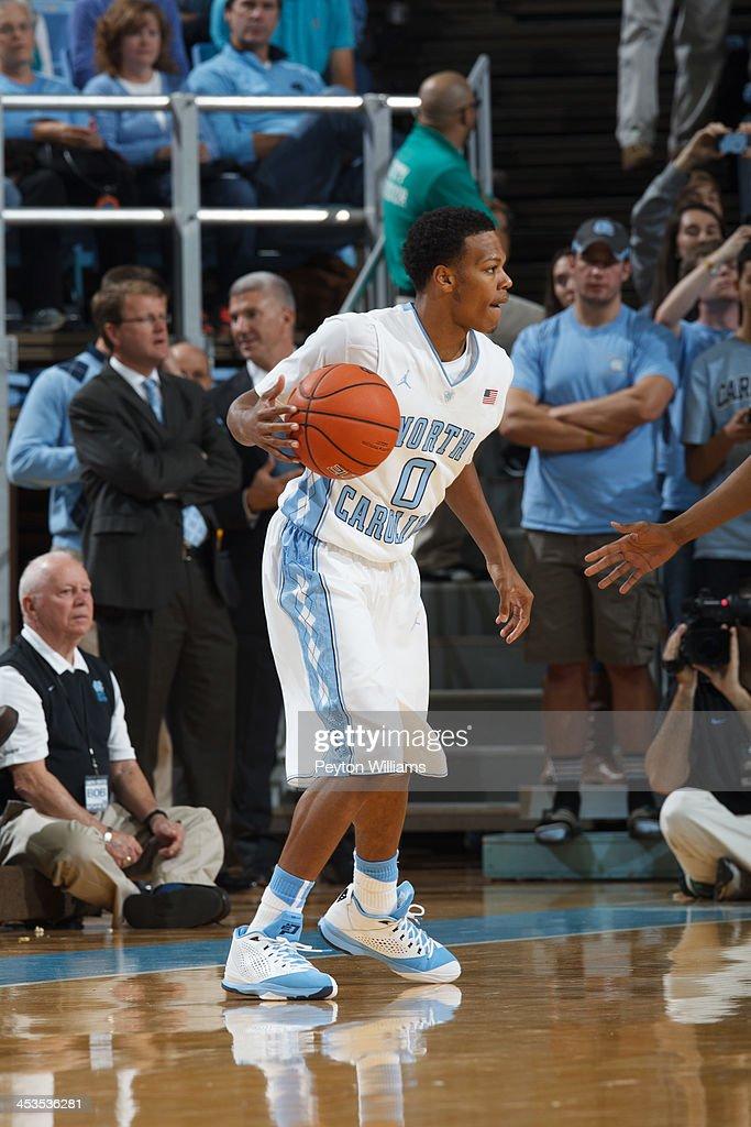 Nate Britt #0 of the North Carolina Tar Heels plays the Oakland Grizzlies on November 08, 2013 at the Dean E. Smith Center in Chapel Hill, North Carolina. North Carolina won 84-61.