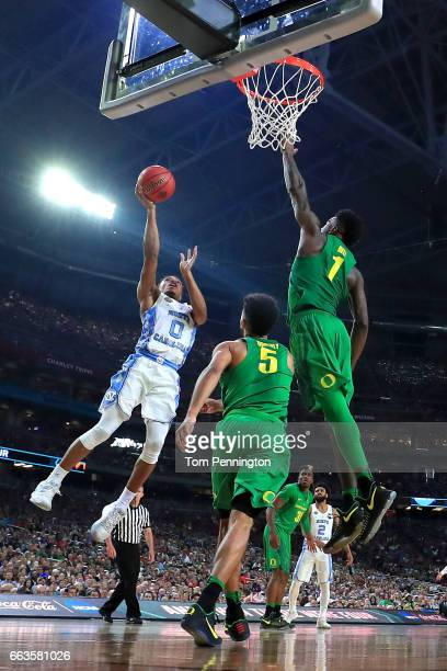 Nate Britt of the North Carolina Tar Heels shoots against Jordan Bell of the Oregon Ducks in the second half during the 2017 NCAA Men's Final Four...
