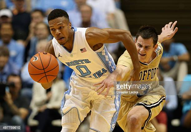 Nate Britt of the North Carolina Tar Heels steals the ball from Fletcher Magee of the Wofford Terriers during their game at Dean Smith Center on...