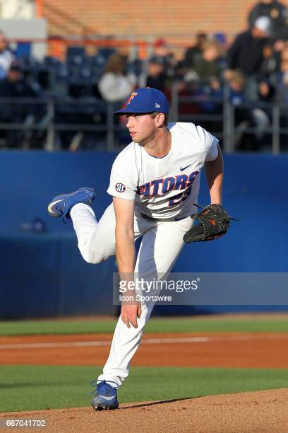 Nate Brown of the Gators delivers a pitch to the plate during the college baseball game between the Florida State Seminoles and the Florida Gators on...