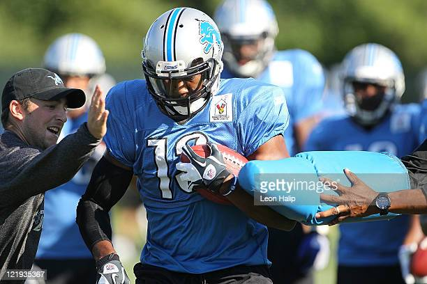Nate Burleson of the Detroit Lions runs through the morning drills during training camp at the Detroit Lions Training Facility on August 23 2011 in...