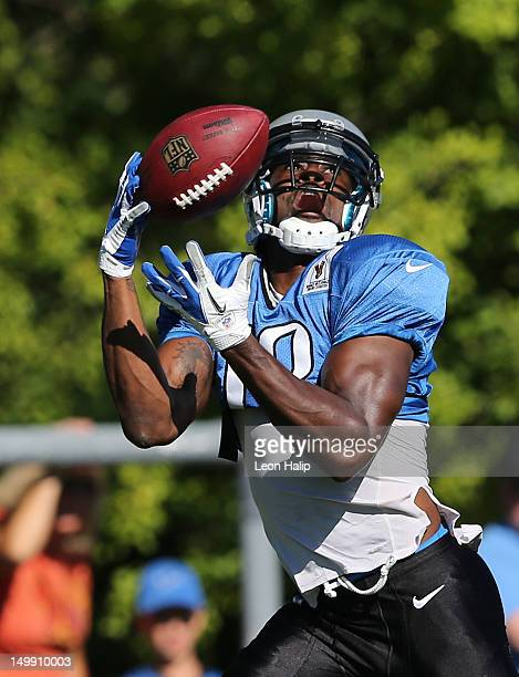 Nate Burleson of the Detroit Lions runs through the morning one on one drills during Lions training camp on August 06 2012 in Allen Park Michigan