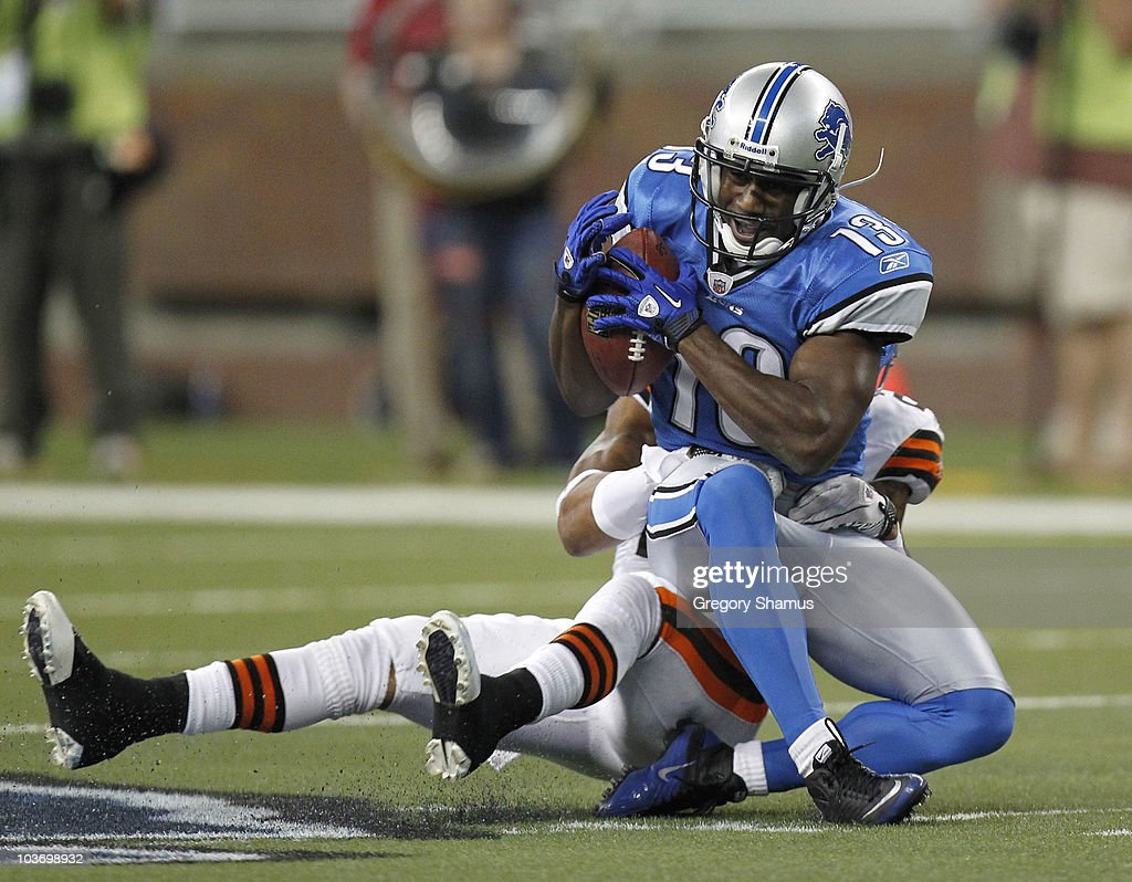 Nate Burleson #13 of the Detroit Lions tries to escape the tackle of Eric Wright #21 of the Cleveland Browns in a preseason game on August 28, 2010 at Ford Field in Detroit, Michigan.