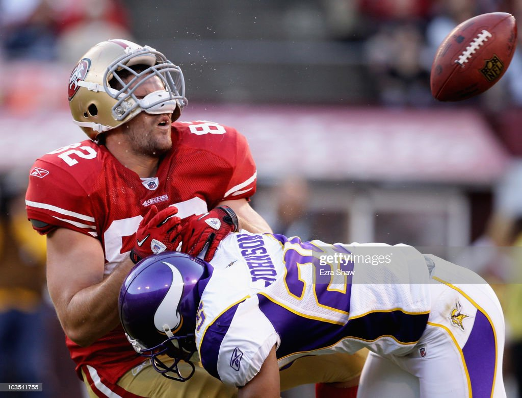 Nate Byham #82 of the San Francisco 49ers is hit by Tyrell Johnson #25 of the Minnesota Vikings during a preseason game at Candlestick Park on August 22, 2010 in San Francisco, California.