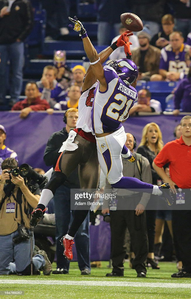 Nate Byham #82 of the Tampa Bay Buccaneers attempts the catch while Josh Robinson #21 of the Minnesota Vikings applies pressure at the Hubert H. Humphrey Metrodome on October 25, 2012 in Minneapolis, Minnesota. There was a flag on the incomplete pass attempt.