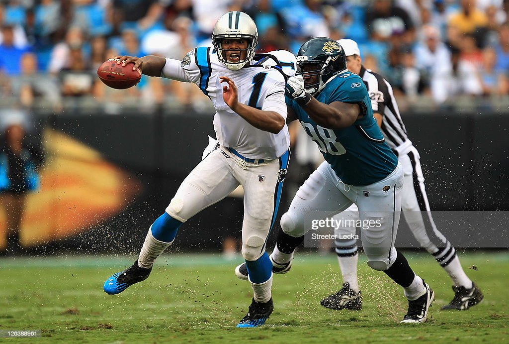 Nate Collins #98 of the Jacksonville Jaguars tries to tackle <a gi-track='captionPersonalityLinkClicked' href=/galleries/search?phrase=Cam+Newton+-+American+Football+Quarterback&family=editorial&specificpeople=4516761 ng-click='$event.stopPropagation()'>Cam Newton</a> #1 of the Carolina Panthers during their game at Bank of America Stadium on September 25, 2011 in Charlotte, North Carolina.