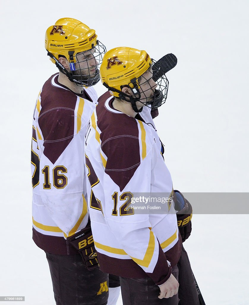 Nate Condon #16 and Justin Holl #12 of the Minnesota Golden Gophers react after a loss of the semifinal game of the Big Ten Men's Ice Hockey Championship against the Ohio State Buckeyes on March 21, 2014 at Xcel Energy Center in St Paul, Minnesota. The Ohio State Buckeyes defeated the Minnesota Golden Gophers 3-1.